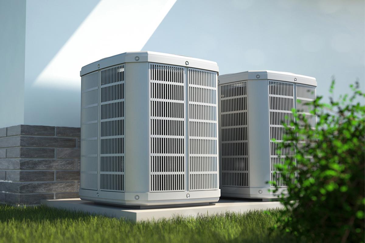 Air heat pumps beside a house